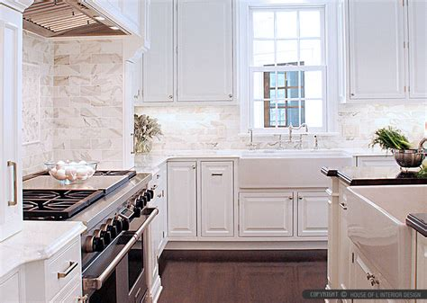 calacatta gold subway tile white kitchen cabinets