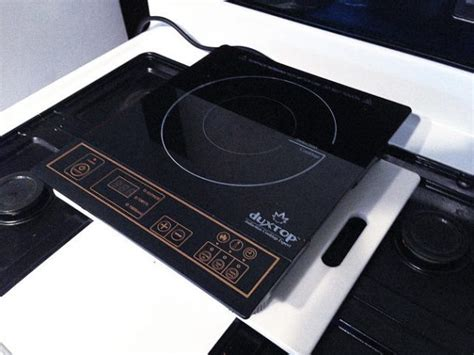 induction cooktop vs gas stove here s why induction stove tops are more efficient than