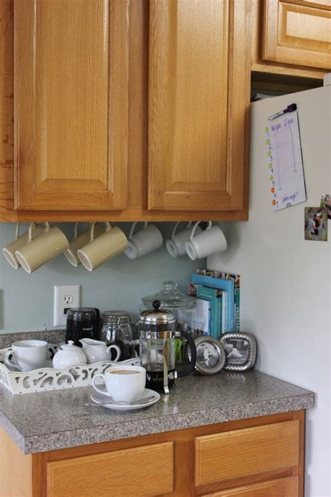 hang coffee cups under kitchen cabinet with hooks makes