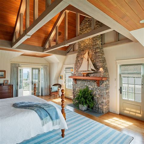 beach style bedroom traditional stone fireplace used as a decorative element
