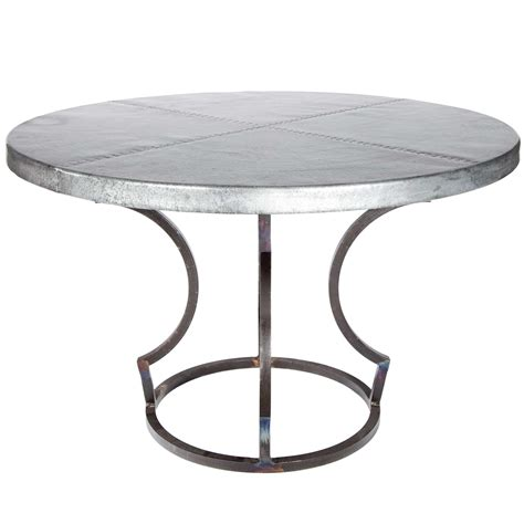 round zinc table top pictured here is the charles dining table with wrought