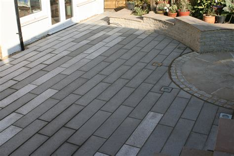 mixed shade granite paving with cropped stone walling