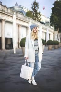 s grey beanie white overcoat white and black fair