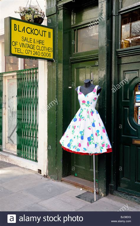 vintage 1950 s dress on stand in outside blackout