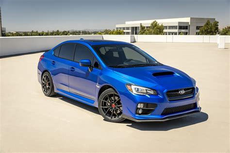 custom blue subaru electric blue subaru wrx sitting on vorsteiner wheels