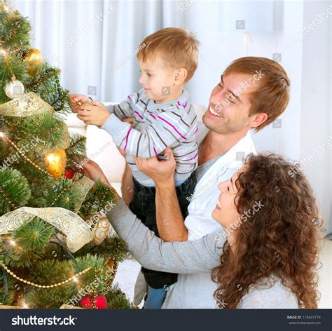 family christmas tree jarrettsville happy family decorating tree together stock photo 119447779