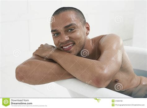 man in a bathtub man relaxing in bathtub stock photo image 31836790