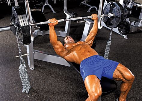 chain bench press why do people put chains on the barbell while lifting