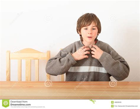 boy sitting wooden table stock photo image 48808595