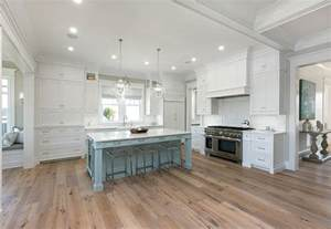 wood kitchen cabinets with wood floors white cabinets with powder blue kitchen island and sawn