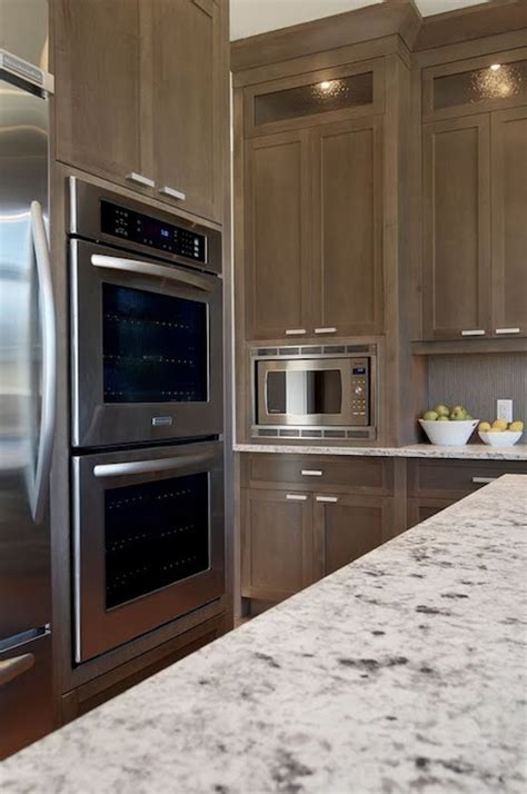 grey brown stained kitchen cabinets white granite countertops transitional kitchen
