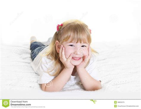 laying in bed in spanish sweet little blonde girl lying happy on bed stock photo image 38823275
