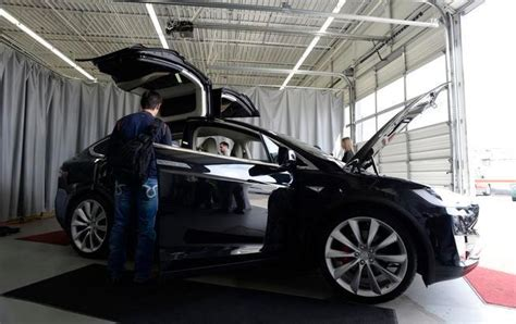 tesla model x electrifies denver owners who plunked