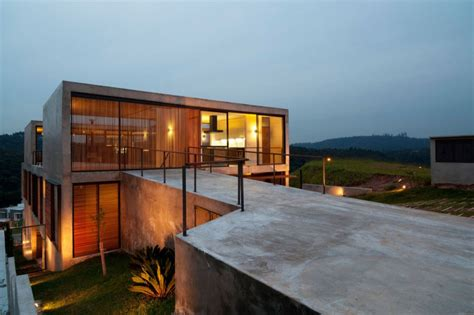 creative contemporary all wood hillside home design hillside house with 2 concrete volumes 2nd story entrance
