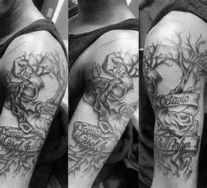 Cool mens banner wrapped around family tree upper arm tattoos