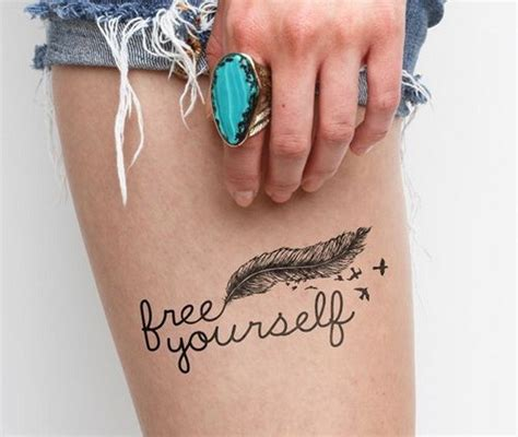 feather tattoo with quote on arm lovely feather bird with quote tattoo on thigh