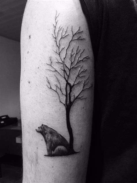 bear tree tattoo sitting against tree tree