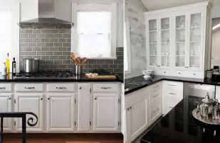 white kitchen cabinets with black countertops reawbll
