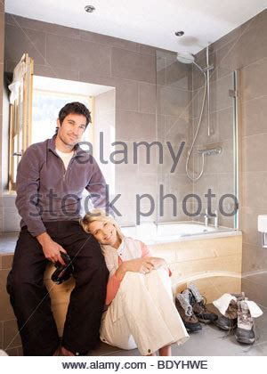 man and woman in bathroom man and woman together in a bathtub eating and bathing after a 15th stock photo