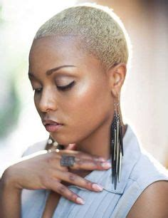 african american women hairstyle thats shaved on both side inspiring short bald white blonde haircut with jewelry