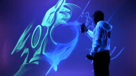 black light spray paint artist uses fluorescent spray paint to create glowing art