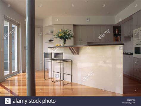 modern kitchen dining open plan with pillars and breakfast narrow pillar and wooden flooring in modern open plan