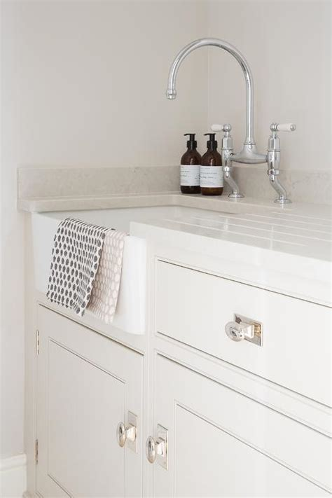 laundry room cabinet knobs ivory mudroom cabinets with oval knobs transitional
