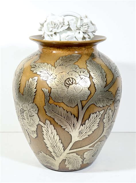 Pottery Vase Designs ceramic pottery urn vase with relief designs in silver