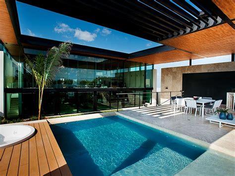 amazing house  seijo peon arquitectos boasts impressive pool   garage