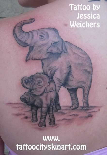 elephant mom and baby tattoo elephant and baby on back