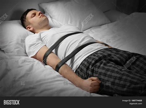 tied up in bed young man tied belts bed image photo bigstock