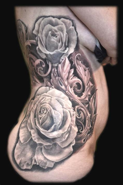 roses and filigree rib tattoo by maximilian rothert tattoos