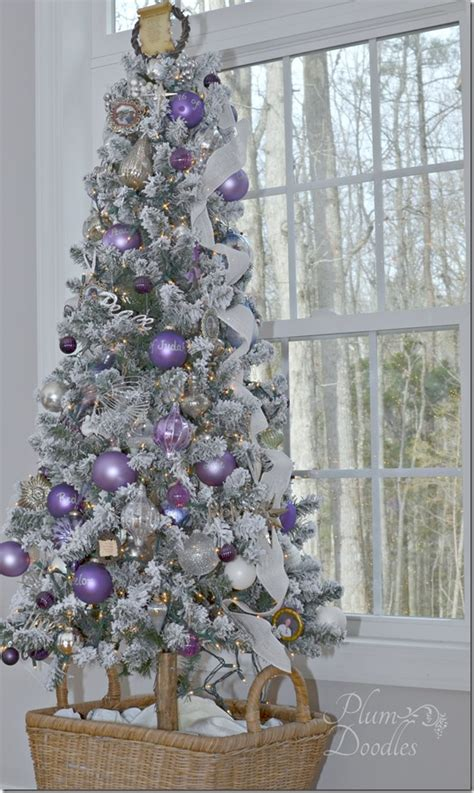 a purple white and silver themed christmas tree silver