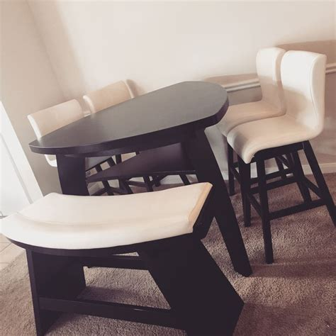 Our triangular dining table with two tone bench and swivel
