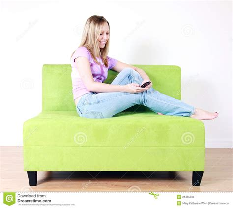 teen on couch teen girl texting on couch stock photos image 21455533