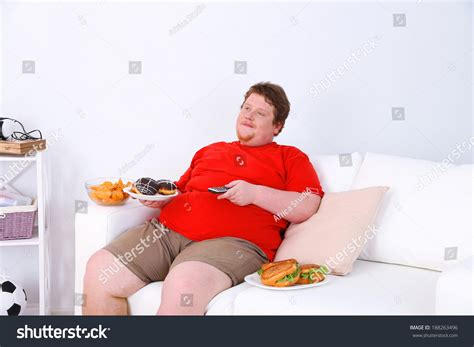 lazy on couch lazy overweight male sitting fast food stock photo