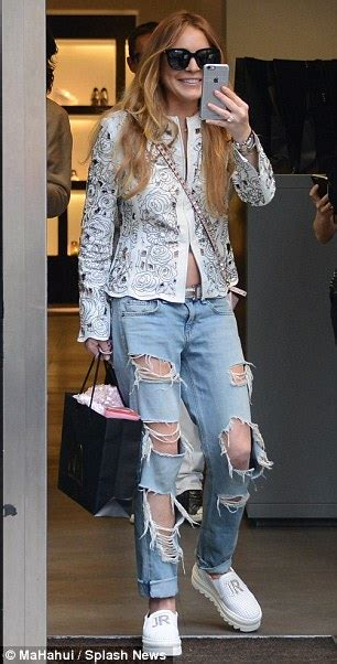Lindsay Lohans Of Excitement by Lindsay Lohan Changes Shoes And Top During Shopping