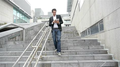 building a single stair walk up better cities towns man walking down stairs with tablet hi res video 14830136