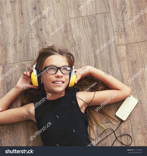 9 years child is lying on the floor and listening