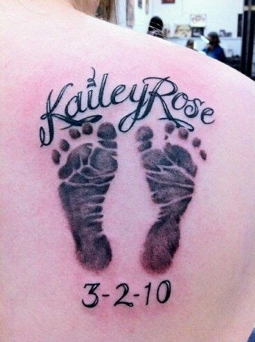 tattoo designs baby feet this baby foot prints tats piercings