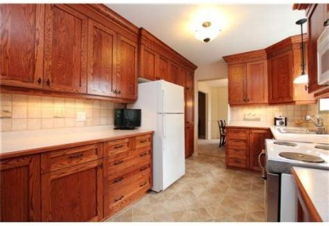 red kitchens with oak cabinets what harware finish would you suggest with these red oak