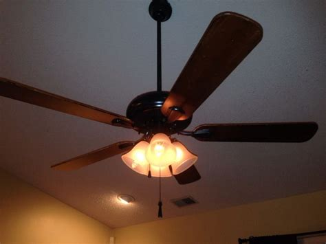 Spray Paint Ceiling Fan by Spray Painted White Ceiling Fan With Gold Trim Used A