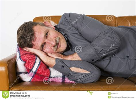 laying couch man laying on couch stock photo image 42552439