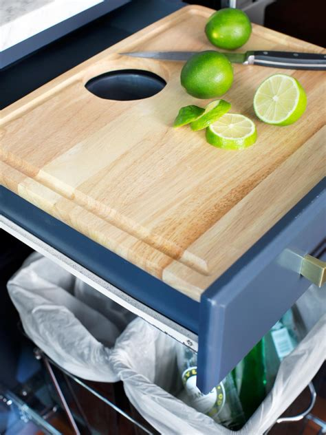 cutting board drawer above trash can pack storage and style into a kitchen kitchen designs