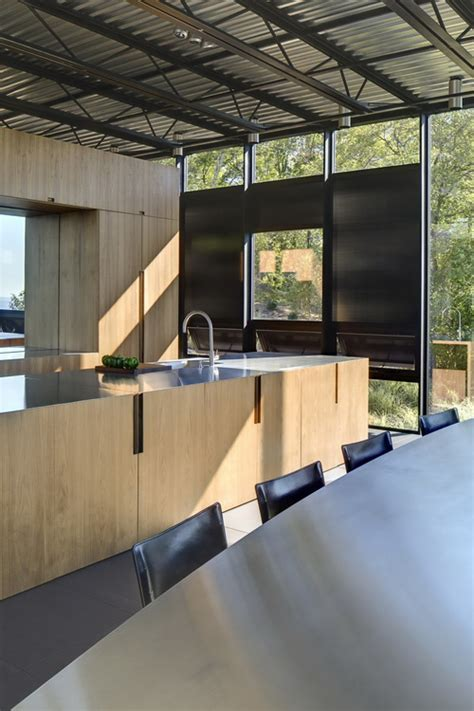 desain rumah industrial desain rumah kaca reflektif bergaya industrial yang