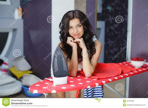 service housebeautiful com happy woman ironing royalty free stock photo