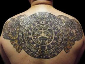 a tattoo of the mayan calendar surrounded by mayan serpent