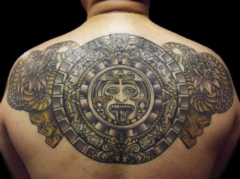 a of the mayan calendar surrounded by mayan serpent