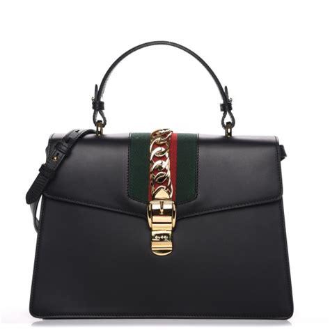 Gucci Positano Medium Top Handle Bag In Black by Gucci Calfskin Medium Sylvie Top Handle Bag Black 217903