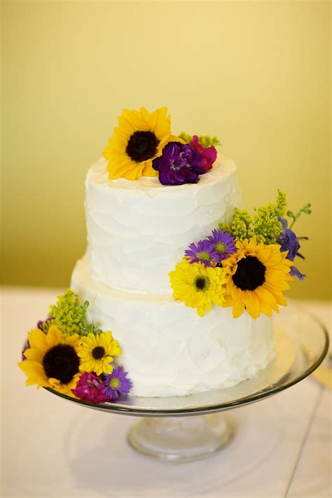 yellow  purple flower decorated wedding cake